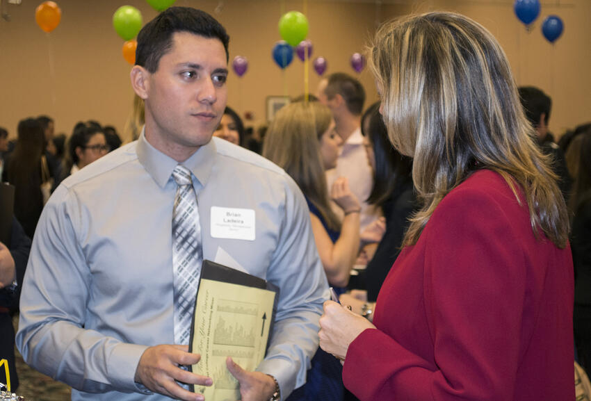 Student meeting with potential employer at job fair