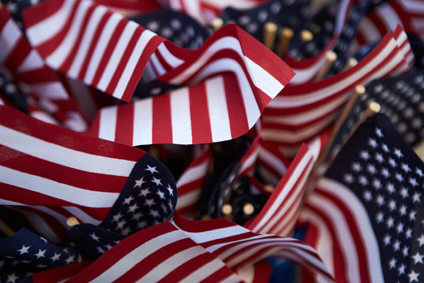 Closeup of several small American flags