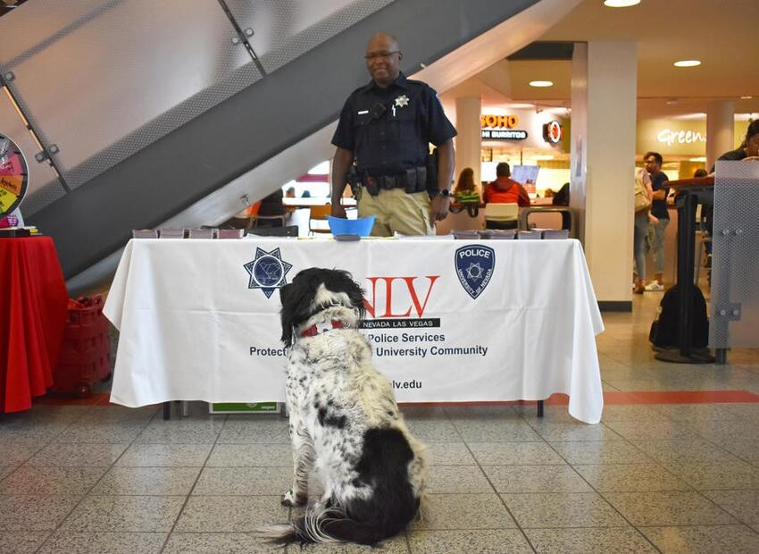 Officer Johnson and Buster (a dog) at the Rebel Round Table registration event
