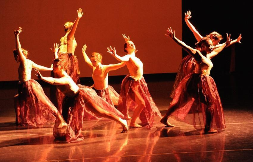 A group of dancers on stage.