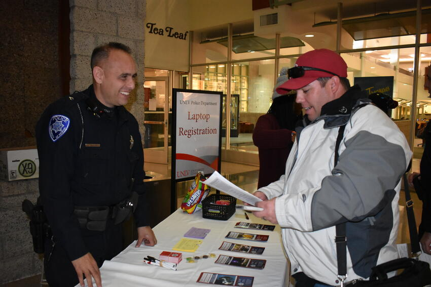 UNLV Police officer and student at property registration table