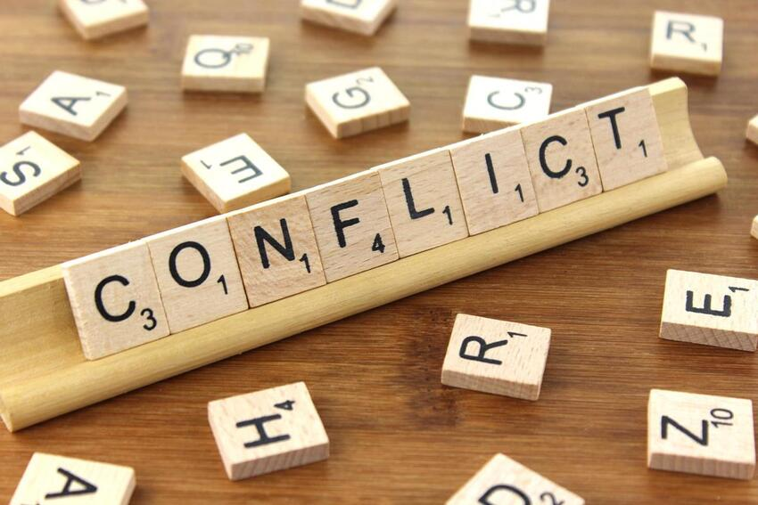 """squared letters that form the word """"conflict"""""""