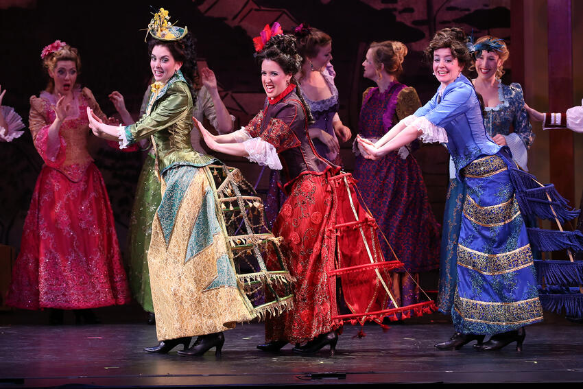 Performers on stage in The Mikado